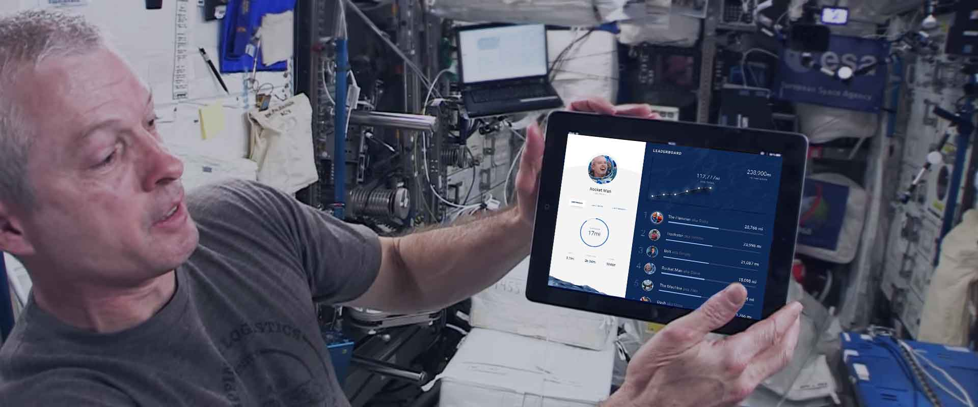 NASA Astronaut Holding Tablet with To The Moon experience