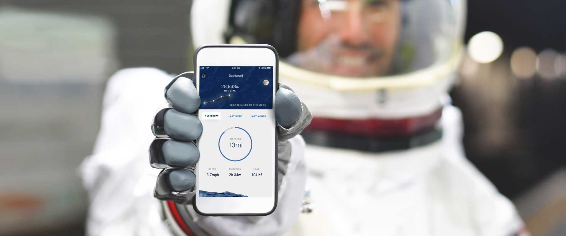 Astronaut holds mobile phone showing app dashboard