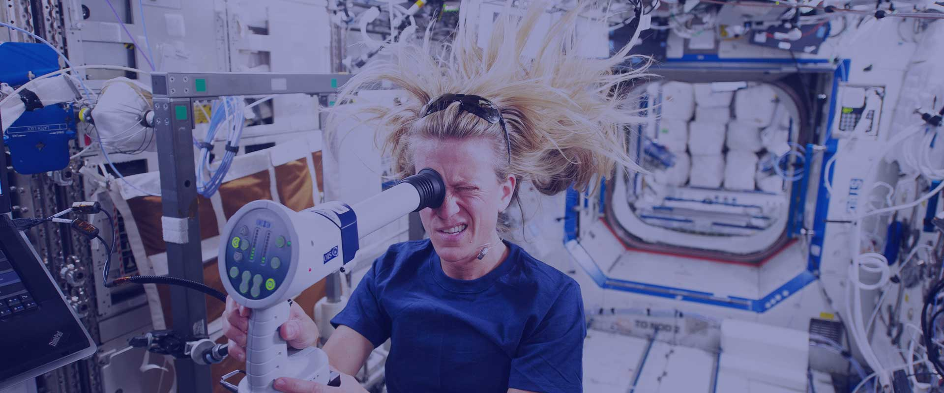 Astronaut checking her ocular health on board the ISS